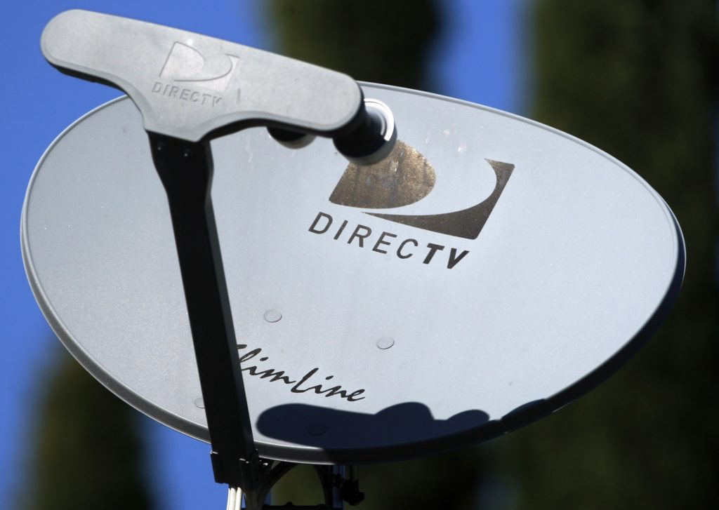 In this Feb. 10, 2009 photo, a DirecTV satellite receiver dish is seen on a home in Simi Valley, Calif. DirecTV Group Inc., the nation's largest satellite TV provider, said Thursday, April 7, 2009, that its first-quarter profit dropped 46 percent as costs and expenses increased on promotions offered to draw in new customers and keep existing ones.  (AP Photo/Reed Saxon)